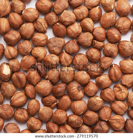 Surface covered with multiple hazelnuts as a background composition texture - stock photo