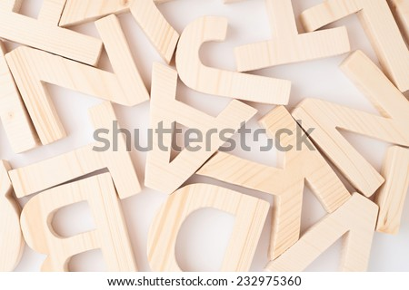 Surface covered with multiple wooden letters as a background composition - stock photo