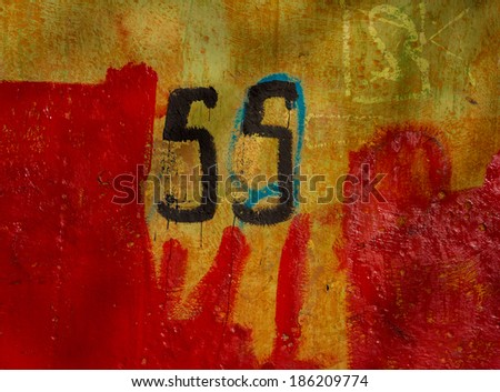 surface covered with old plaster walls partially painted paint - stock photo