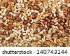 Surface covered with peanut, hazelnut, walnut, almond, pistachio nut mix - stock photo
