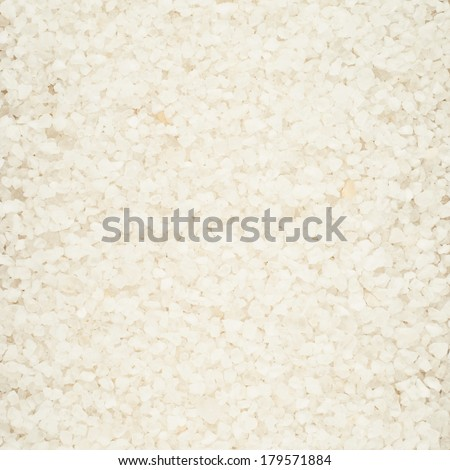 Surface covered with salt crystals as a background - stock photo