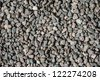 Surface covered with small natural gravel stones - stock photo