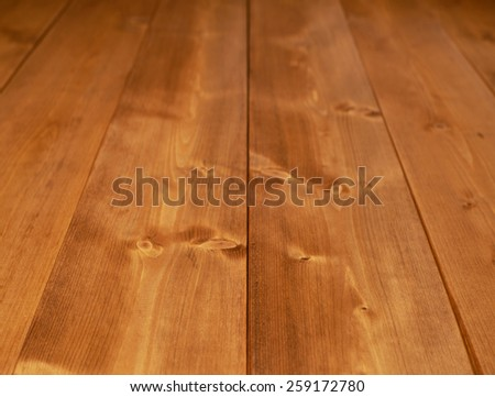 Surface covered with the multiple brown paint coated pine wood boards as a shallow depth of field background composition - stock photo