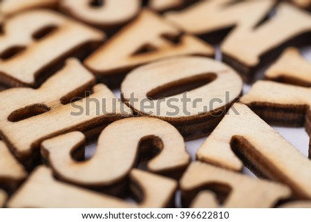 Surface covered with wooden letters