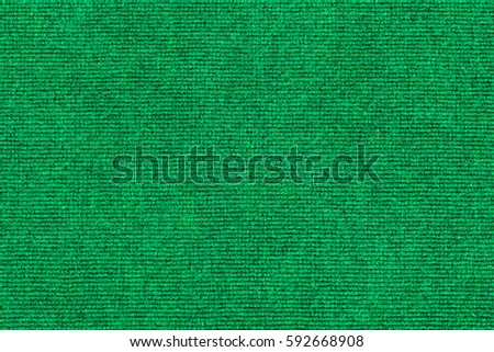 green carpet texture. surface green microfiber plastic carpet mat texture. background with pattern for design. great texture