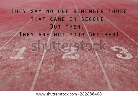 Surface of a running track with the inspirational message: They say no one remember those that came in second. But then, they are not your brother!  - stock photo