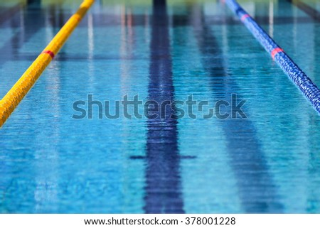 surface of an outdoor olympic swimming pool