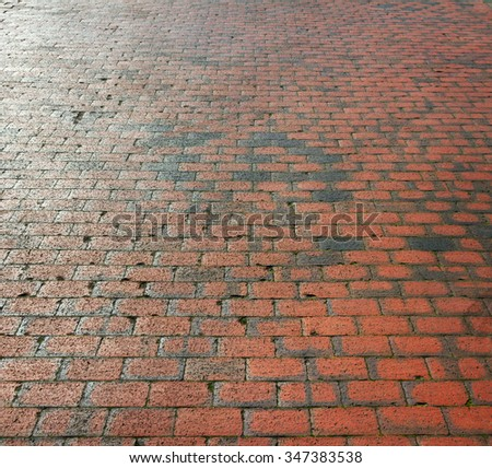 Surface of brick pavement in an England. - stock photo