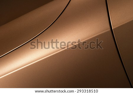 Surface of bronze sport sedan car, detail of metal hood, fender and door of vehicle bodywork  - stock photo