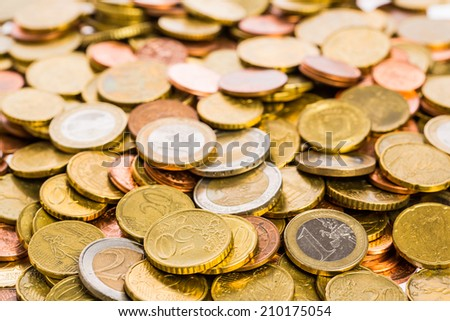 Surface of many euro coins - stock photo