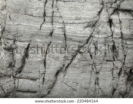 Surface of natural stone with large cracks - stock photo
