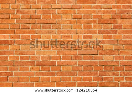 Surface of red regular  brick wall texture - stock photo