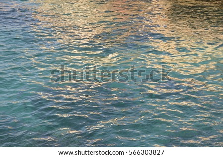 surface of sea water, the glare on the water background with water texture  Save Download Preview The surface of water, forming interesting texture with glare.