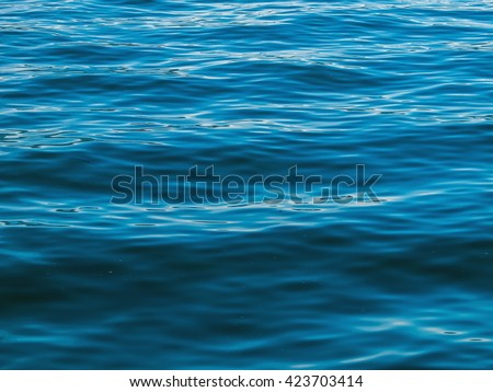 Surface of the Water on a Bright Day from a Boat - stock photo