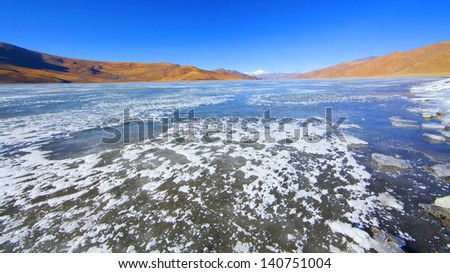 Surface of transparent fissured  ice of The Lake in winter - stock photo