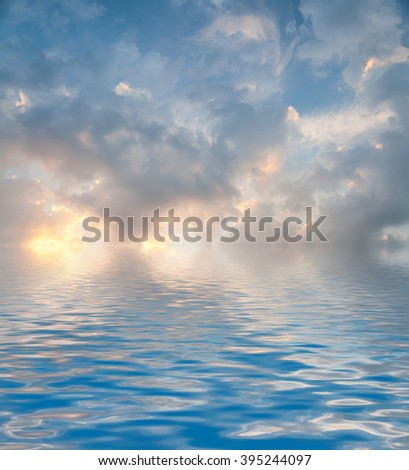 Surface Rippled of water with clouds and sky background