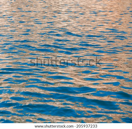 surface seawater covered with colorful reflections