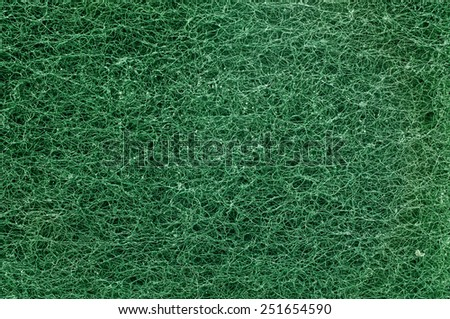 Surface texture of clean scrubber in green color for background or wallpaper - stock photo