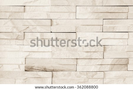 Surface wall of stone wall sepia tones for use as background. The new design of modern stone wall. pattern of decorative stone wall surface. - stock photo