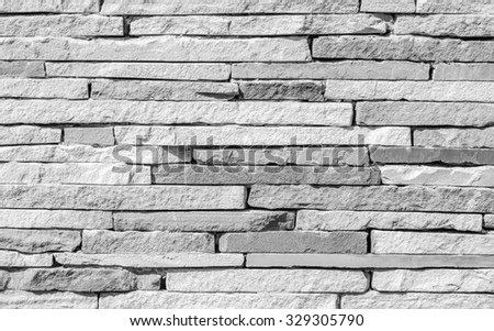 Surface wall of stone wall stones gray for use as background : The new design of modern stone wall : pattern of decorative stone wall surface. - stock photo