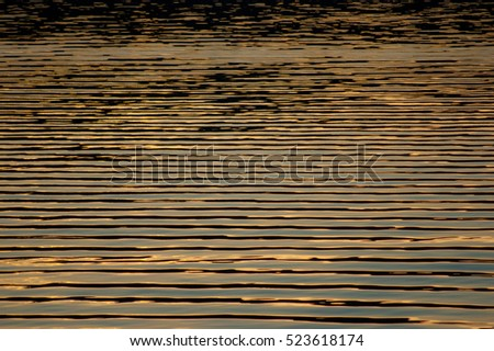 Surface water in the sunset time. Abstract background