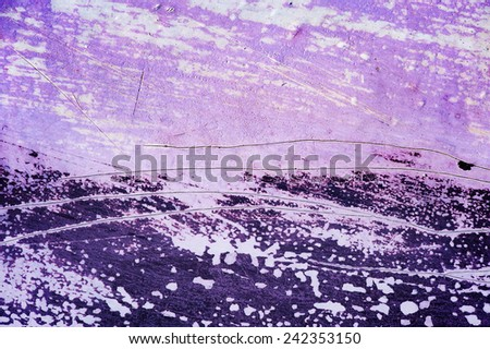 Surface with discolored purple paint flaking and cracking background texture - stock photo