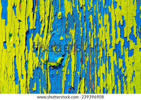 Surface with multicolored paint flaking and cracking background texture - stock photo