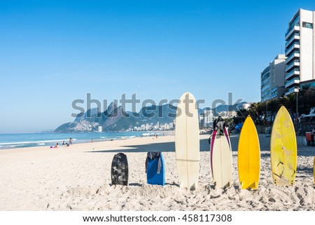 Surfboards standing upright in bright sun on the Ipanema beach, Rio de Janeiro, Brazil