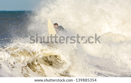 Surfer among splashes and waves - stock photo