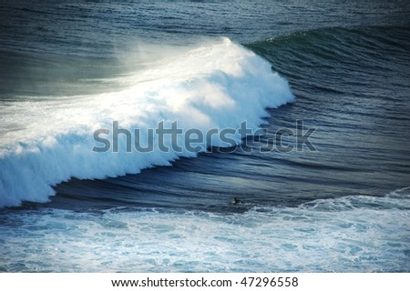 Surfer and the big wave - stock photo