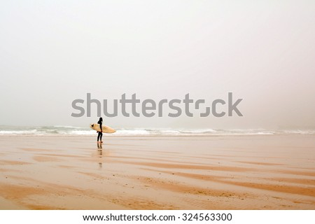 Surfer at Praia do Amado, Beach and Surfer spot at the Algarve Portugal Europe - stock photo