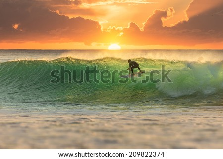 Surfer at Sunrise with Perfect Wave