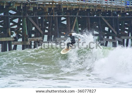 Surfer going off the top of the wave - stock photo