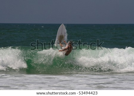 surfer going through wave - stock photo