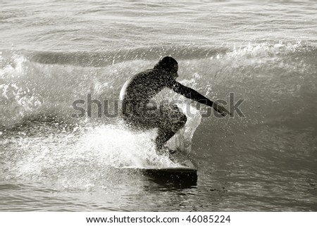Surfer in black and white, Biarritz, France - stock photo