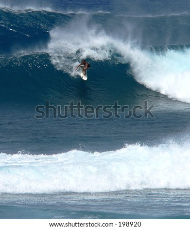Surfer in heavy surf on Maui's north shore - stock photo