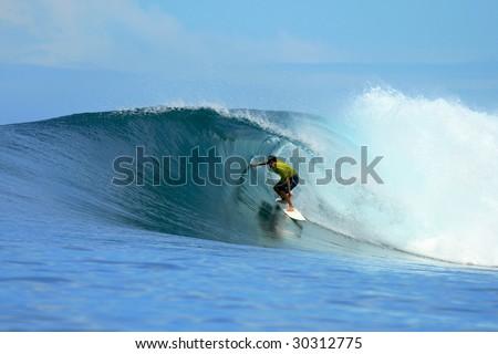Surfer in yellow t-shirt in barrel, Mentawai Islands, Indonesia - stock photo
