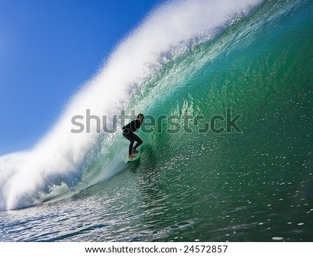 Surfer on a  Big Beautiful Wave in an Epic Tube - stock photo