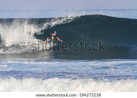 Surfer on Blue Ocean Wave. - stock photo