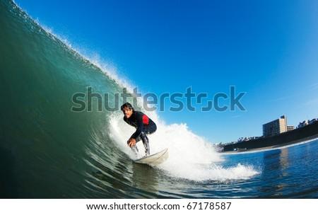 Surfer on Blue Ocean Wave - stock photo