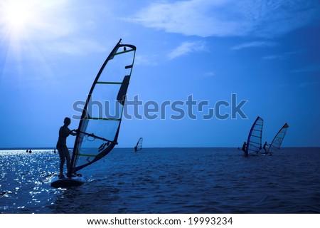 Surfer on sunshine on waves - stock photo
