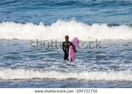 Surfer on the way to the sea