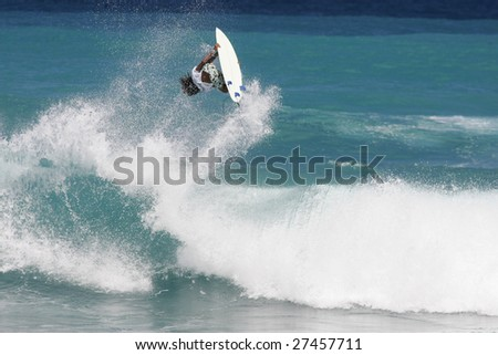 surfer riding ocean wave