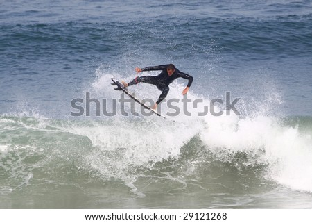 surfer riding ocean wave in Anglet ( france)