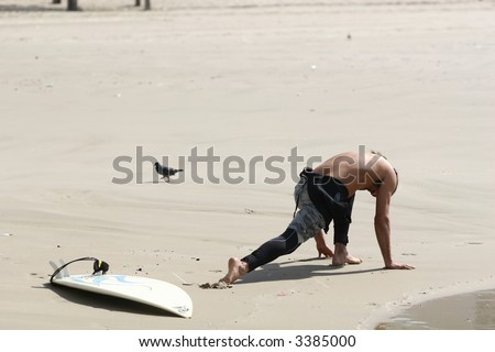 surfer streching before going to sea - stock photo