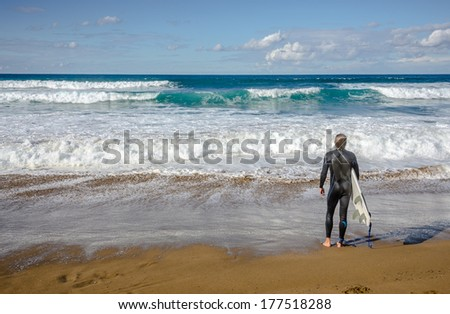 Surfer watching the waves in Zarautz, Spain - stock photo