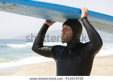 Surfer with a board on top - stock photo