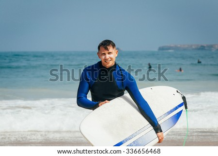 Surfer with surfboard - stock photo
