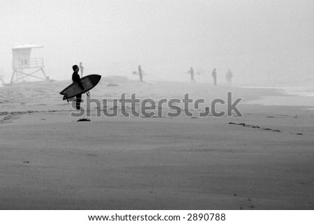 surfers check out the waves in Huntington Beach California aka Surf City - stock photo