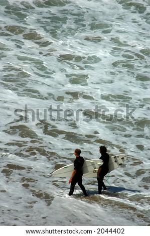 Surfers in the Tide Pools of Laguna Beach, California - stock photo